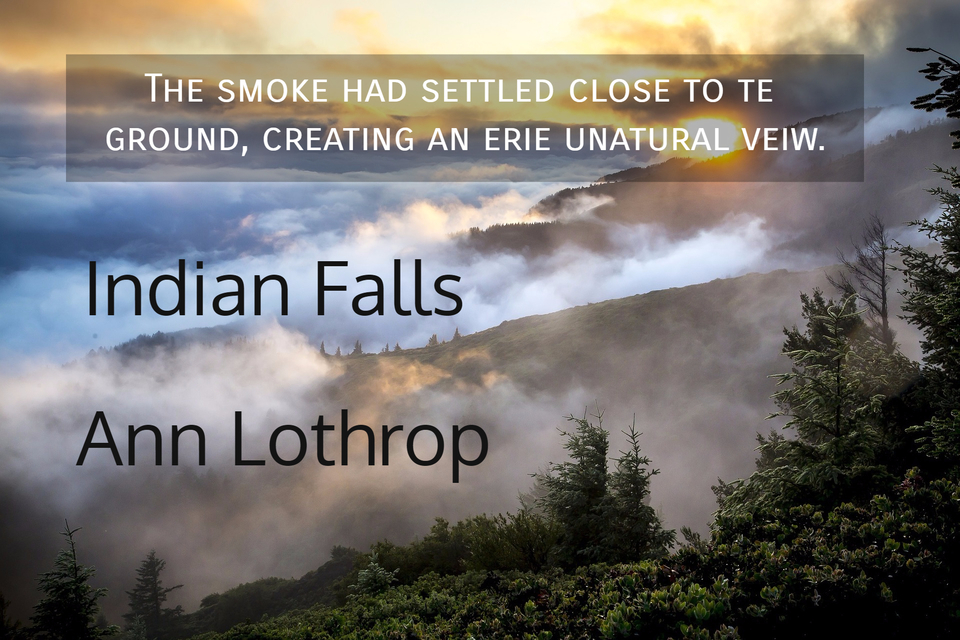 the smoke had settled close to te ground creating an erie unatural veiw...