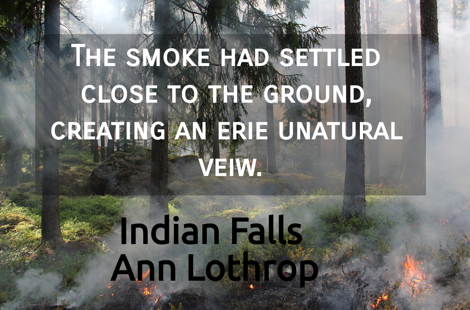 the smoke had settled close to the ground creating an erie unatural veiw...